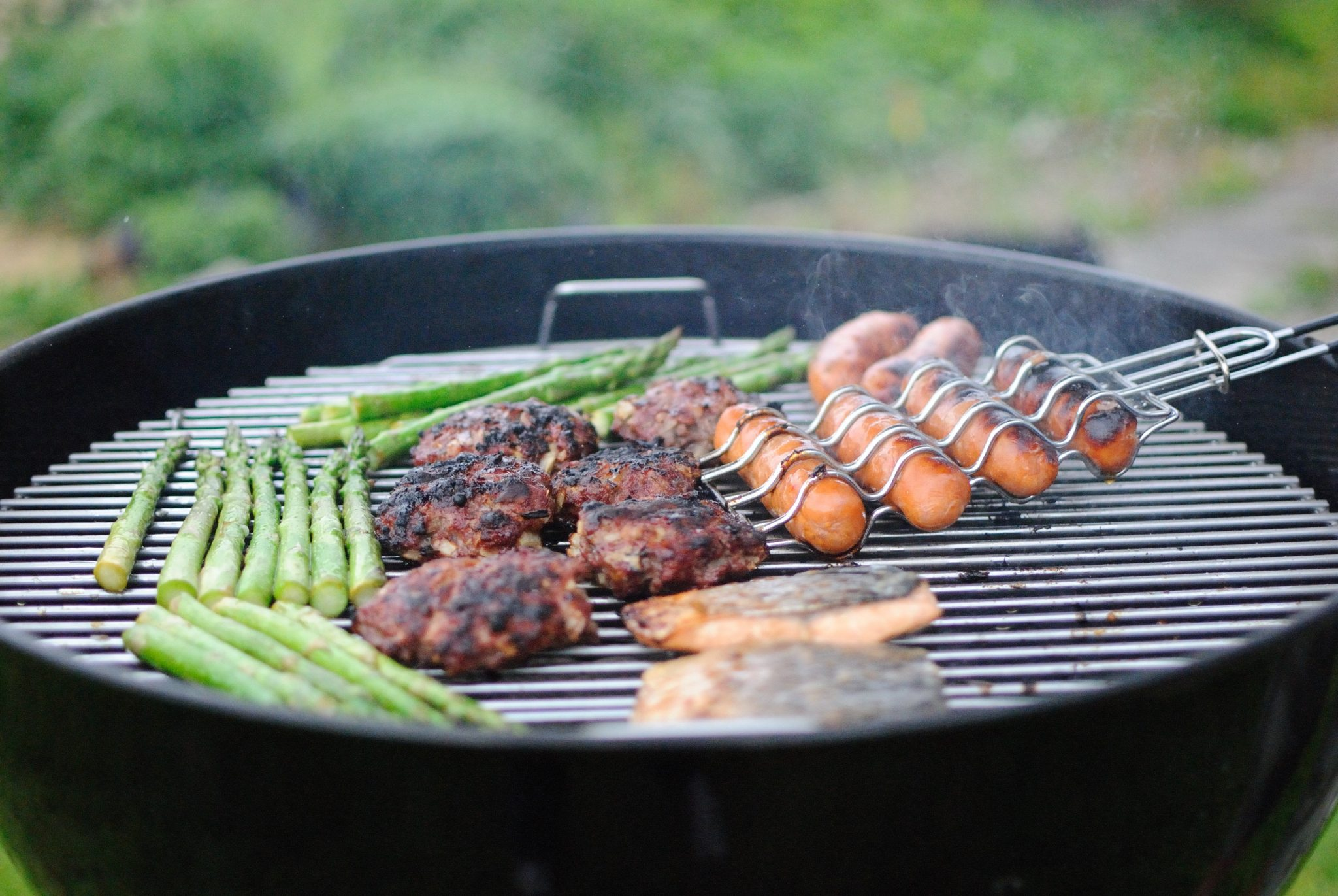 Grilling outdoors at Tailgate for Football Game Catered