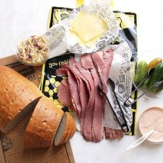 Sliced Loaf of Bread, sliced lean corned beef, dill pickles, russian dressing, swiss cheese, coleslaw